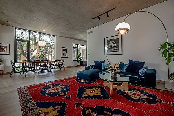 """Photo #5 Exposed concrete ceiling and 7"""" french white oak floors throughout"""