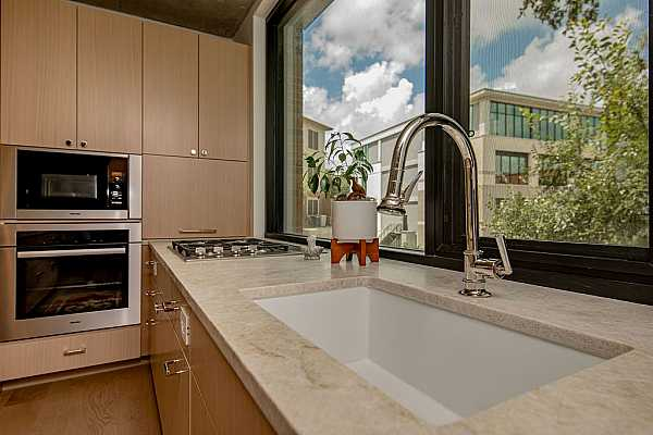 Photo #8 Full line of Miele appliances paired with Taj Mahal quartzite in the kitchens and baths with Waterworks fixtures throughout