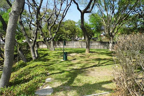 Photo #22 Green space is located across from carport, overlooked by the upstairs primary bedroom.