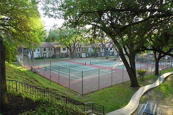Photo #27 Tennis Courts and picnic area around pool and club house.