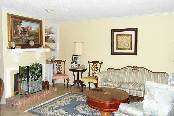 Photo #3 Living Room from pool side front door entrance.  Fireplace, built-in bookcase, adjacent to dining room.