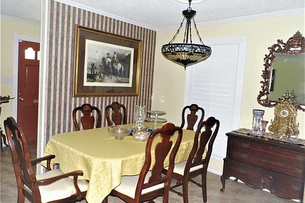 Photo #6 Dining Room from hallway, plantation shutters.