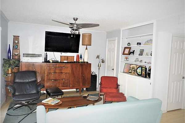 Photo #7 Den with built-in bookcase, storage and coat closet.