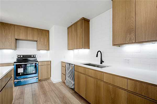 Photo #7 Stainless steel appliances featuring an electric range.