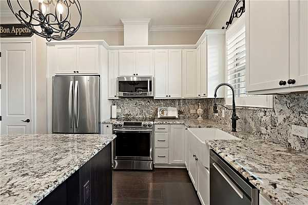Photo #12 Note the backsplash is solid granite; all Level 5.