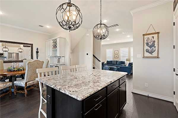 Photo #13 Kitchen island allows dine-in seating and separates the kitchen and dining room.