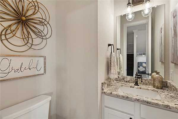 Photo #20 Powder room with Level 5 granite; located on 2nd floor with family room, kitchen, and dining rooms.
