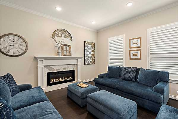 Photo #7 Family room with heated Napoleon Electric Fireplace with remote control.