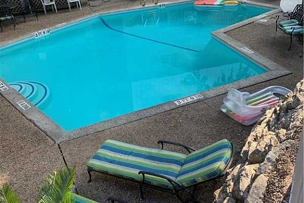 Photo #4 Nice secluded shaded community pool/ also storage area and laundry room