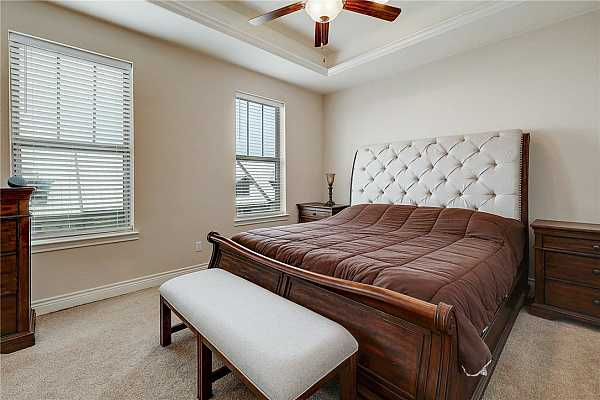 Photo #16 Primary bedroom on the 3rd floor with abundant natural light and coffered ceilings.