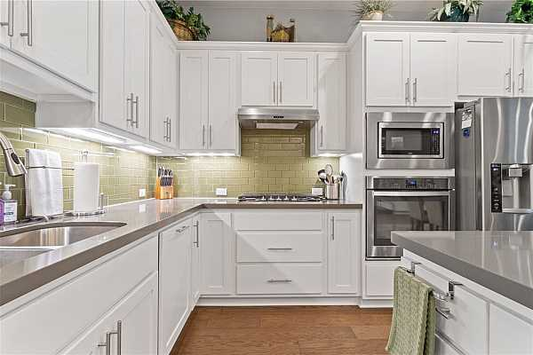 Photo #11 Two large storage closets off the kitchen provide space for all your pantry items or appliances that aren