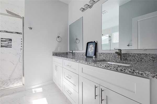 Photo #11 Master bathroom with oversized vanity, abundance of storage space and walk-in Spa shower