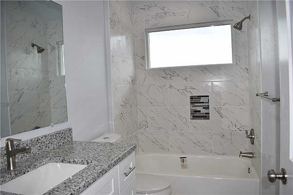 Photo #14 Second Bathroom with Granite countertop and Soft close shaker cabinets.