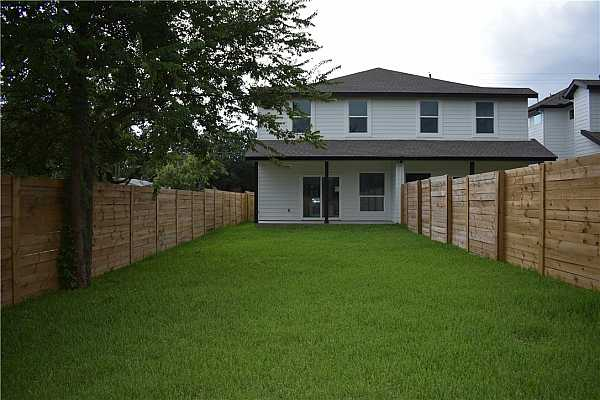 Photo #15 The private, fully fenced and landscaped large backyard with two fruit trees. This home is minutes away from downtown!