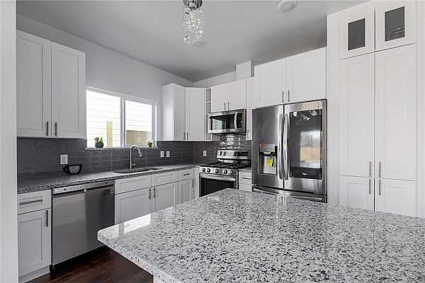 Photo #5 High End Stainless Steel Kitchen Appliances including Smart Refrigerator And soft close pull-out cabinets in Panty