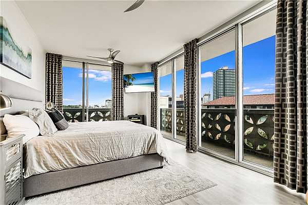 Photo #17 Master bedroom of this corner unit.  Views for miles.  University of Texas is to the right and you can lie in bed and see the UT Tower.  The school is walking distance from the Cambridge Towers.  Two ceiling fans keep air circulating in this amazing room.