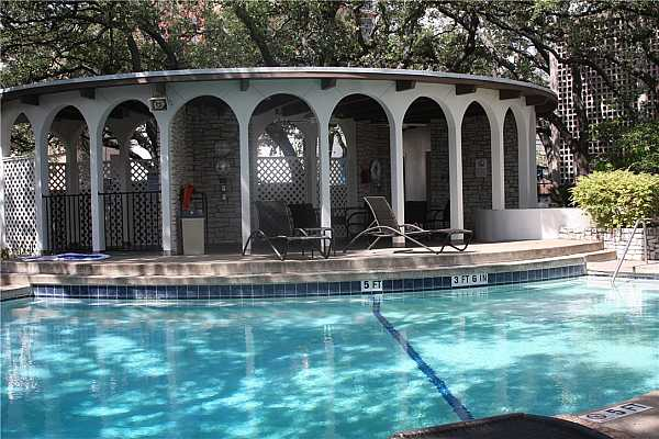 Photo #24 Pool with Gazebo to relax.  Barbeque grills off to right of photo.