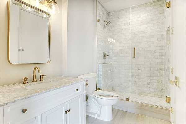 Photo #12 Guest Bathroom with Marble counter and walk-in shower