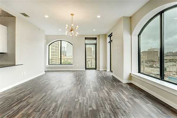 Photo #8 Natural light and stunning light fixtures in living