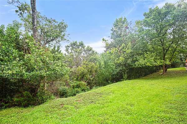 Photo #23 Experience the incredible scenic views of the surrounding nature from the front patio.