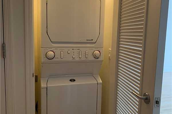 Photo #11 Stackable Washer and Dryer off kitchen