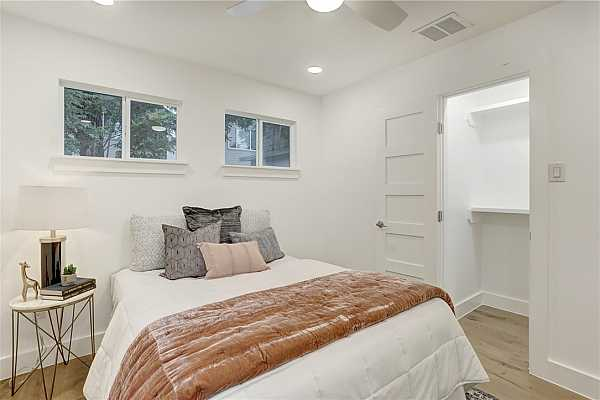 Photo #11 Primary bedroom features lots of natural light and a large closet.