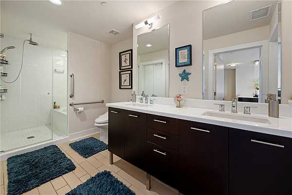 Photo #16 Large bathroom with dual vanity and wet room