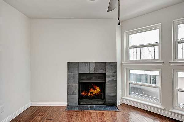 Photo #3 2 great windows next to the fireplace provide an abundance of natural lighting.