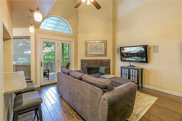 Photo #3 Wood floors and glass doors to the patio make this an upscale living room