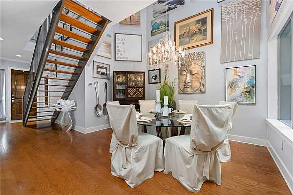 Photo #18 2 story dining room is beautiful & dramatic.