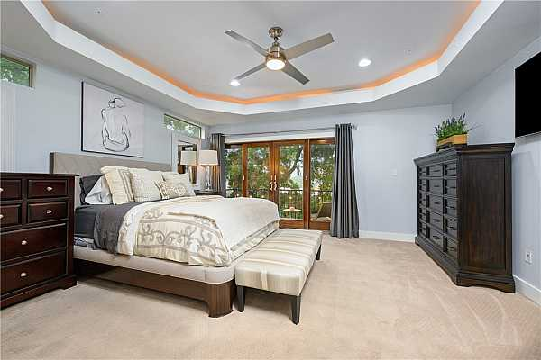 Photo #24 Huge primary bedroom with private balcony.