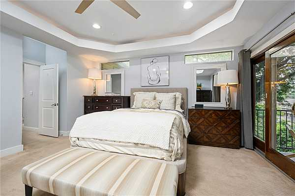 Photo #25 Very spacious with tray ceiling & tons of natural light.