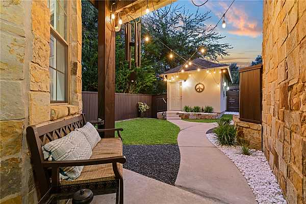 Photo #34 Peaceful & private front courtyard. Spacious 1 car, detached garage.