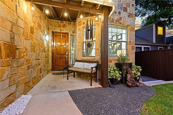 Photo #6 Lovely covered front porch. There is also a 1 car detached garage & double carport!