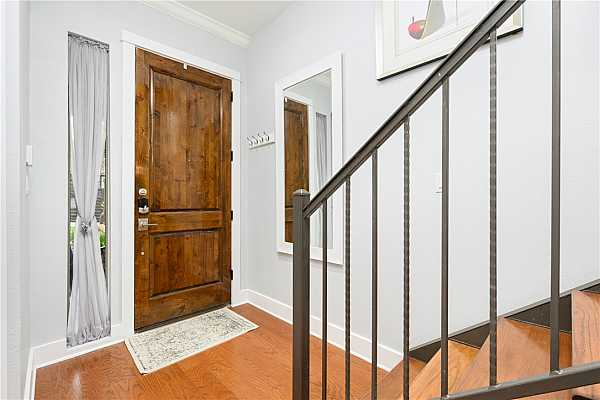 Photo #7 Lovely foyer. There is a bedroom and full bathroom downstairs just off the entry hall.