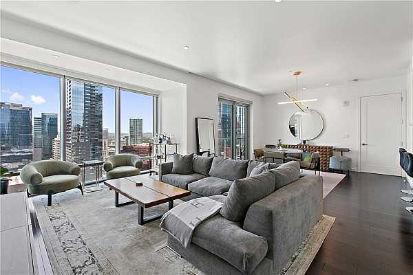 Photo #1 Large open concept living and dining room with stunning city and lake views