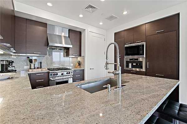 Photo #9 Tons of kitchen storage and counterspace