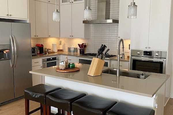 Photo #12 Kitchen area with island and extra seating for casual dining