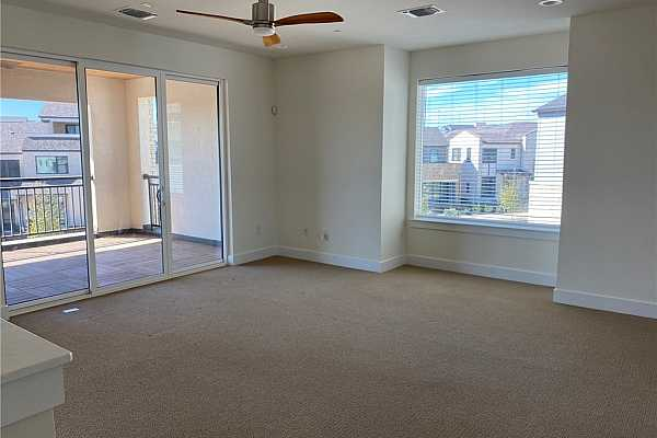 Photo #27 3rd level large den with access to the big covered terrace with views of downtown and the landscaped Paseo