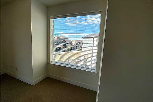 Photo #29 Den cubby which would be great for a desk or reading nook. Nice view of the landscaped Paseo and rain garden