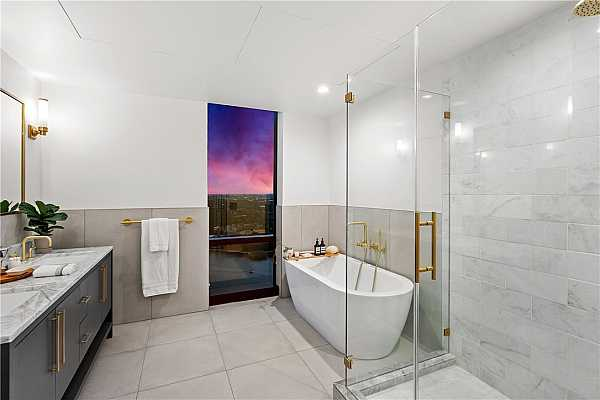 Photo #16 Frameless glass shower and freestanding tub in the primary bathroom