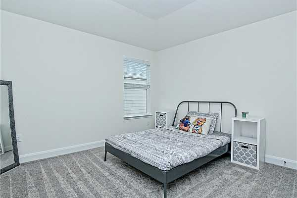 Photo #18 The game room offers plush carpet flooring, recessed lighting, and a vaulted ceiling.