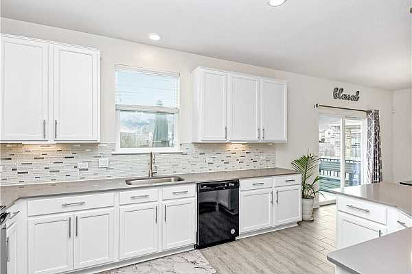 Photo #8 With sight lines from the dining room into the kitchen and living room, you