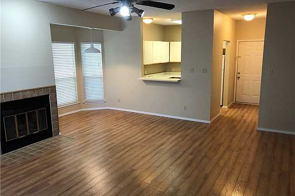 Photo #2 Kitchen with dishwasher, disposal, oven, cooktop, microwave and refrigerator.