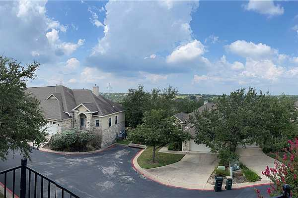 Photo #1 Welcome home to 10300 Morado Cove #802! Enjoy the ease of lock and leave lifestyle in this gated condo community.