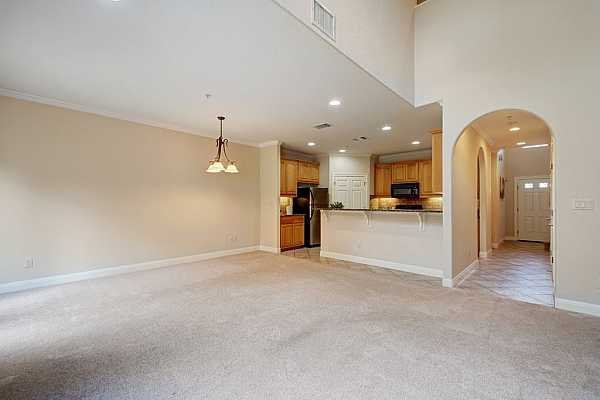 Photo #10 High ceilings with lots of natural sunlight in the living/dining area.
