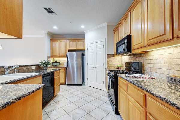 Photo #17 The kitchen has a large pantry for storage and extra countertop space.