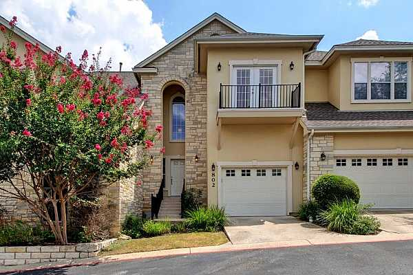 Photo #2 Two story condo with 2 bedrooms, 1 1/2 baths and a 1 car garage. Close to the Arboretum, Great Hills and the Domain.