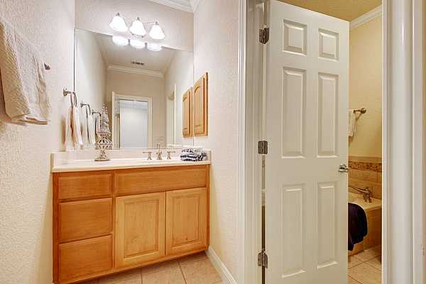 Photo #28 First floor guest hall half bath with built in cabinets.