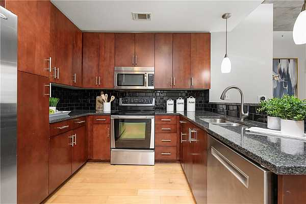 Photo #3 Stainless steel appliances and ample storage space